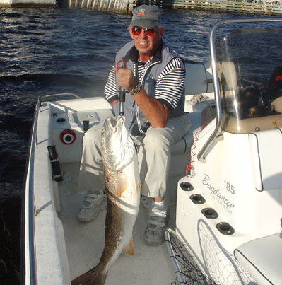 Sarde Howell, pioneer of handicapped fishing tackle, shows this trophy red drum pulled from bridge pilings. At the right times, bridges provide excellent structure for a variety of fish.